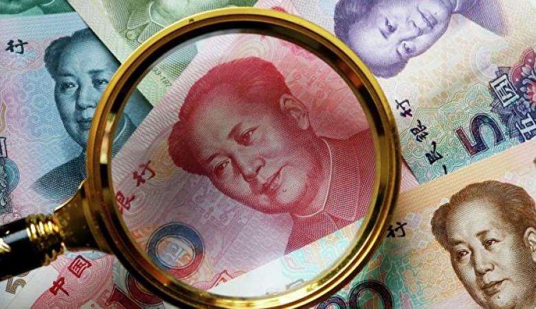 Курс юаня кдоллару опустился на1%