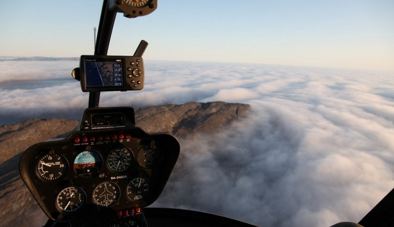 Работа по поиску вертолета на Алтае с воздуха приостановлена из-за тумана