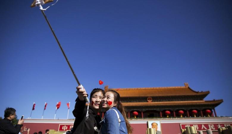 Китайцы празднуют 68-ю годовщину образования КНР